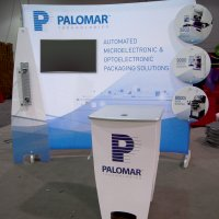 Customized 10x10 HangTen with monitor, stand-off graphics, and bag holder designed by Vision Exhibits