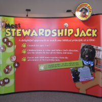 Curved pop-up display with stand-off graphics and mural designed by Vision Exhibits