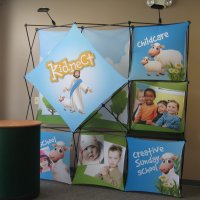 8' XPlus with fabric graphics and case to counter kit designed by Vision Exhibits