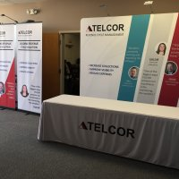 TELCOR accommodates 10x20 and 10x10 spaces with the 10' Envision backwall and bannerstands. From Vision Exhibits.