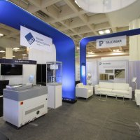 Palomar Technologies equipment is highlighted by fabric archways and LED-lit graphics.